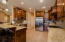 Granite counters and stainless steal appliances throughout the kitchen.