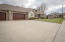 Large over-sized 3 car garage with large concrete driveway.