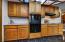 Kitchen features new designer tile backsplash