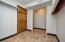Large Laundry featuring chute from first floor hall bathroom and storage/hobby area