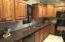Alder cabinets, Nail head knobs, Granite tops, full app. package