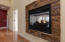 Double sided gas fireplace welcomes you as you enter the front door.