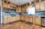 Custom built maple cabinets galore and commercial grade appliances are a chef's delight.
