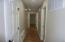 HALLWAY BACK TO BEDROOMS. FIRST DOOR TO THE RIGHT IS THE UTILITY ROOM, AND NEXT DOOR ON RIGHT IS HALL BATH.