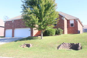 All brick home with three car garage, deck on back , three bedroom, two bath, turnkey home.