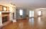 OPEN FLOOR PLAN SHOWS FULL VIEW INTO THE DIING AREA AND KITCHEN