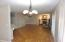 LOOKING BACK FROM DINING AREA THROUGH THE LIVING ROOM. GLEAMING, MANUFACTURED HARDWOOD FLOORS THROUGHOUT