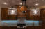 STRIKING LIGHT FIXTURE OVER THE KITCHEN BAR, BUT PLENTY OF CAN LIGHTING TO ALWAYS SEE WELL WHILE COOKING!