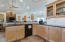 Granite counter tops, glass doors to show off your decorative pieces.