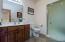Basement bath has a walk-in shower.