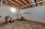 Unfinished storage above the John Deere room.