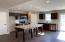 Kitchen with storage closet, stainless steel appliances, walk in pantry, center island & granite counter tops