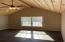 Master Bedroom with board and batten vaulted ceiling