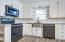 Beautiful kitchen with lots of natural light, granite and stainless appliances