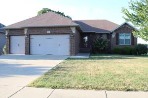 Beautiful brick front w/ stone accents and 3 car garage home on a large corner lot!