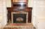 FIREPLACE WITH CUSTOM MANTLE AND INSERT.