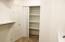EXTRA LARGE LINEN CLOSET SHELVING IN HERE AS WELL.