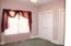 ON THE OTHER SIDE OF THE HOME IS THIS BACK BEDROOM WITH DOUBLE CLOSETS, AND AGAIN, BIG WINDOWS FOR SO MUCH LIGHT!