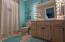 Walk-in shower with vanity