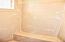 Master Bath shower has a bench & window