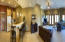 Panoramic view of the basement bar, and family room.