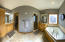 Panoramic view of the master bath with his and her sinks and very large closet and dressing area.