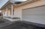 covered front porch, 2 car garage