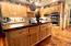 Custom wooden cabinets and authentic wood slab kitchen island counter top