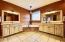 Master bathroom with his and her vanities, jacuzzi tub and walk in shower