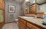 Lovely bath w/ granite counter tops & shower/tub unit.