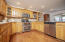 Double oven stove and stainless appliances.