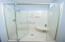 Seller replaced the old gold tone shower with this more modern finish including a pivot door.