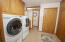 Laundry and pantry space are off the garage, close to the master and kitchen.