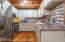 Kitchen with updated backsplash and stainless steel appliances