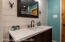 Downstairs bathroom vanity with shiplap and oiled rubbed bronze fixtures