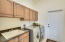 Front Load Washer and Dryer convey with tons of cabinet space