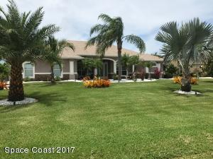 Professionally landscaped 1 acre lot with sprinkler system