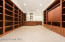 Library with solid mahogany cabinets complete with wet bar, dishwasher and ice maker.