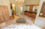 Remodeled Master Bathroom with Double Vanity, Tiled Shower, Jacuzzi Tub and Linen Closet