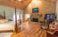 Floor to Ceiling Brick Wood Burning Fireplace meets the 17 ft Vaulted Ceilings covered in Aged Cypress Tongue & Groove Wood