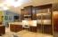 Large Kitchen with cherry cabinets, Bosch appliances and Sub Zero refrigerator
