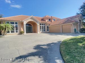 Beautiful pool home on the lake with an over sized 3 car car garage, with large U shaped driveway,barrel tile roof, and the interior was just freshly painted.