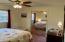 Guest bedroom with mirrored bypass closet door.