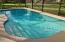 You'll spend many sunny days floating or doing laps in this sparkling blue screen enclosed pool