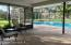 Large screened patio area opens out to pool enclosure - completely surrounded by secluded green space.