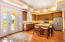 Gourmet, eat-in kitchen with granite counter tops and stainless appliances.