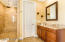 Large step-in shower with no doors to clean or shower curtain needed! With rainfall shower head. Separate make up vanity.