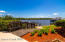Manicured landscaping leads to a private dock, jet ski ramp and 12k lb. boat lift!