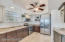 Gorgeous Kitchen with Solid Wood Cabinetry, Granite Counters, Upgraded Stainless Steel Appliances including a Double Oven