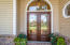 Let's go inside!! Custom Bevel Glass French Doors with Transom above.